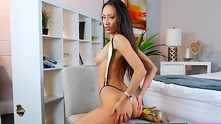 Sexy Model Lucky Lorenzo in gold bikini playing with jugs plus pussy