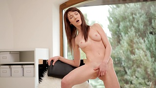 Horny solo model Adrianne spreads her legs prevalent finger her pussy